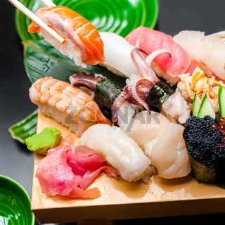 Premium quality sushi rolls served in Japanese restaurant. Asian food background