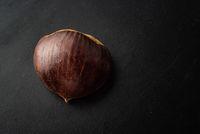 Fresh one chestnut isolated on black background