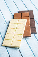 White, milk and dark chocolate bars.