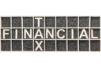 Wooden letters for Financial Tax crossing