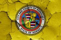 flag of Honolulu on cracked wall