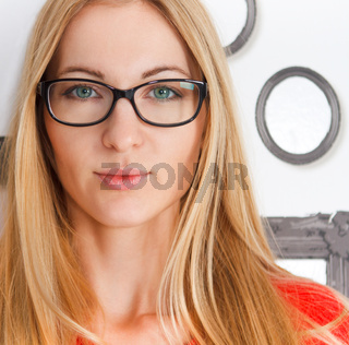 Portrait of the woman wearing black eye glasses