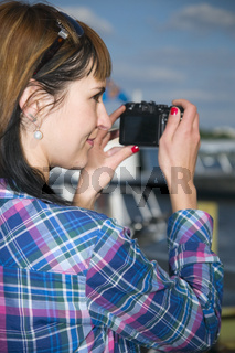 woman with black camera