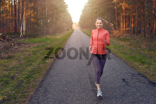 Young fit woman running on a track
