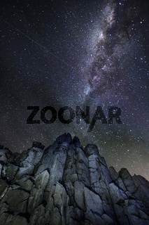 Views of night sky from tall rocky cliffs