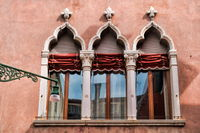 Venice, Italy - 03/18/2019 - Window on an old palazzo