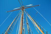 Old sailing ship wood mast, rigging of a sailing ship detail