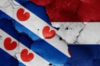 flags of Friesland and Netherlands painted on cracked wall