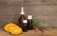Bottle with natural orange, pine and cinnamon oils. aromatherapy and natural cosmetics concept