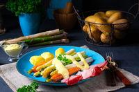 Asparagus with black forest ham, carrots and hollandaise sauce.