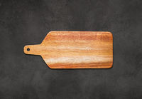 Wooden cutting board isolated on concrete background