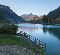 Autumn morning alpine Dolomites mountain lake Alleghe, Belluno, Sudtirol, Italy