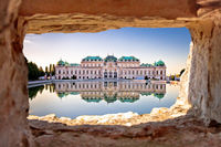 Belvedere in Vienna water reflection view through stone window at sunset