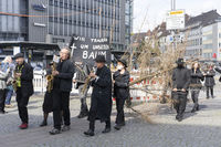 Symbolic Mourning March for a dead Tree