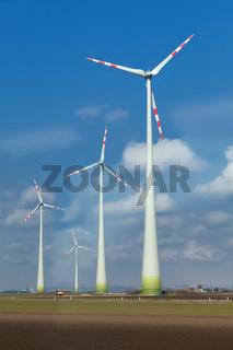 windmills  in cloudy blue sky
