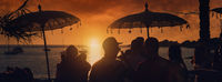 People at sunset on Calo des Moro in Ibiza. Spain