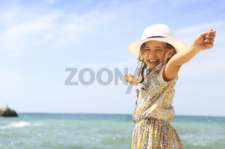 Smiling girl with arms wide open