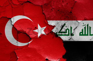 flags of Turkey and Iraq painted on cracked wall