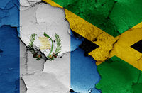flags of Guatemala and Jamaica painted on cracked wall