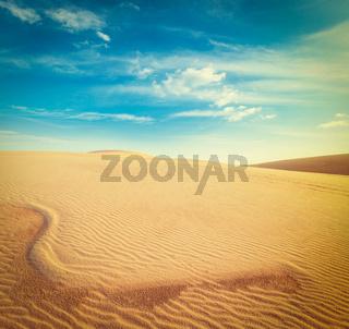 Vintage retro hipster style travel image of white sand dunes on sunrise