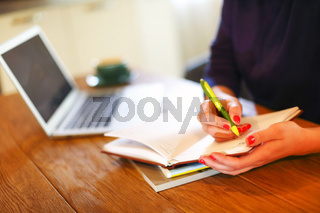 Crop woman working at home