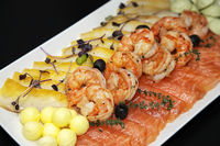 Assorted shrimp, trout and oily fish with balls of oil