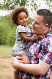 Dad and his little african girl