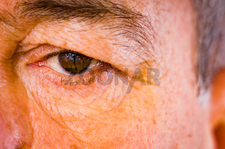 Face detail with an older man's eyes
