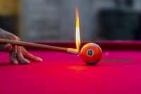 Pool Balls Are Lit On Fire While Sitting On A Pool Table In An Outdoor Environment
