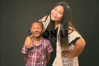 Studio shot of mother and son together against black background