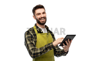 happy male gardener or farmer with tablet pc