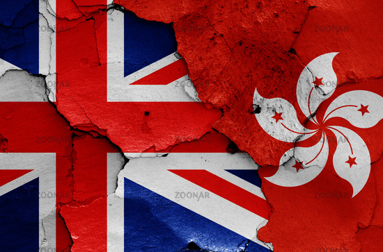 flags of UK and Hong Kong painted on cracked wall