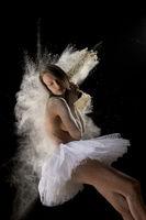 Gentle young female dancer in tutu and powder in studio