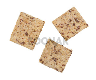 Healthy crackers with chia and flax seeds on white background