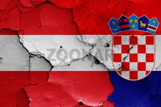 flags of Austria and Croatia painted on cracked wall