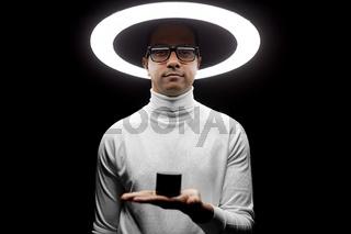 man in glasses with smart speaker under lamp