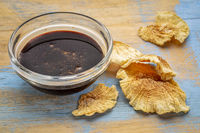 yacon syrup in bowl and tuber slices
