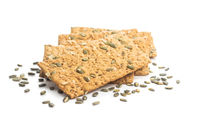 The  crispy bread with pumpkin seeds. Knackebrot on white background.