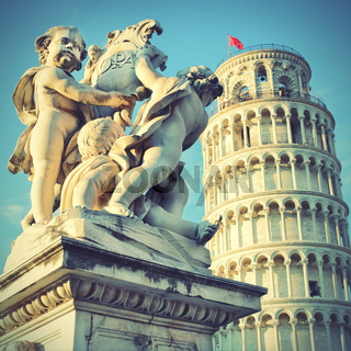 Statue of angels and Leaning Tower