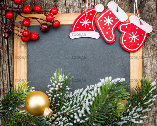 Vintage blackboard blank framed in Christmas tree branch and decorations