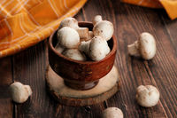 Fresh Whole Organic Mushrooms in a wooden bowl
