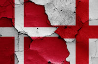 flags of Denmark and England painted on cracked wall