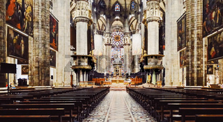 Interior of Milan Cathedral known as Duomo di Milano, historical building and famous landmark in Lombardy region in Northern Italy