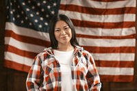 Smiling Asian Woman On America's Flag Background