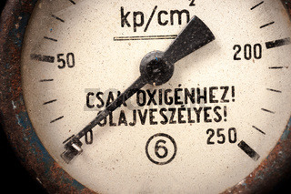 An old measurement device closeup in bright light