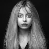 Beautiful young blonde girl with tousled hair