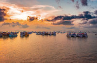 Boats on Mumbai water at dawn. Colaba region of Mumbai, Maharashtra, India.