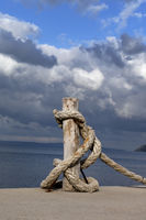 Rope on seafront, sea and beautiful cloudy sky in sun summer day