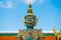 Statue of demon guardian near gates in Grand Palace, Bangkok, Thailand