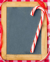 Christmas candy on vintage blackboard